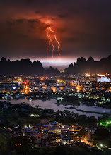 Photo: Spirestorm  When I was in Guilin, China a few weeks ago, I hiked to the top of a mountain. As soon as I got up there, this massive storm rolled in across the mountains into town... it was dramatic a full of fury!