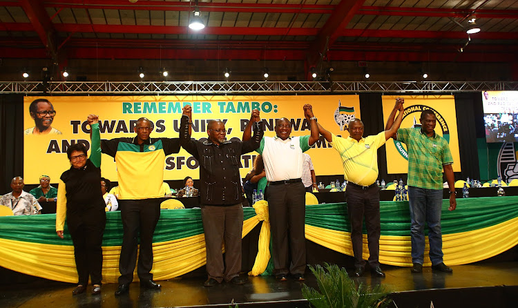 The new members of the ANC top 6, deputy secretary-general Jesse Duarte, secretary-general Ace Magashule, national chairperson Gwede Mantashe, president Cyril Ramaphosa, deputy president David Mabuza and treasurer-general Paul Mashatile hold hands after they were announced at the 54th ANC elective conference at Nasrec on Monday.