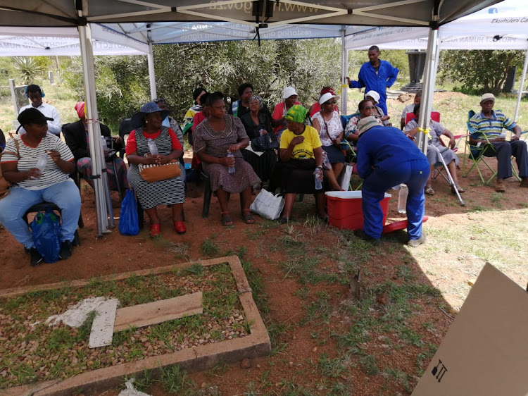 Families of the Mamelodi 10 look on as the body of the last victim is exhumed at Winterveld cemetery.