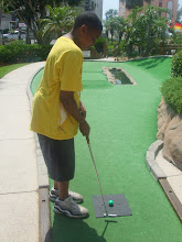 Photo: Miles gets ready to putt