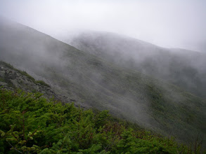 Photo: Cloud-veiled ridges.