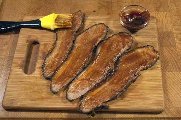 Take the sliced brisket and brush the BBQ sauce on both sides.