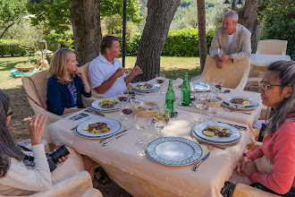 Photo: Kat, Mary, Larry, Mark and Florine with grilled pork and potatoes on the table.