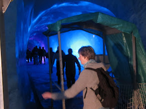 Photo: The caves are lighted with blue light. This was fairly tame, as excursions go, but tomorrow should bring a bit more excitement: we will take the cable-car up Mt. Blanc.