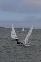 Photo: The guys hike way out of their boats to prevent heeling and keep them flat, which makes them go faster.  It is a tough work out on the sailors abs, quads, hamstrings, calves, etc. and means the sailors get very wet in the oncoming waves.