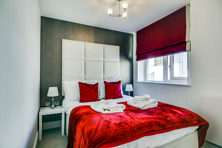 Cosy bed at Duchess House Serviced Apartment