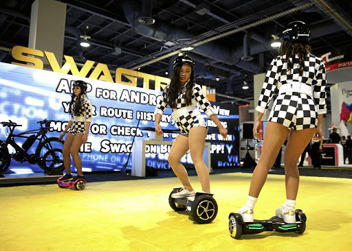 Models perform on Swagtron hoverboards during the 2017 CES in Las Vegas, Nevada. Picture: Reuters