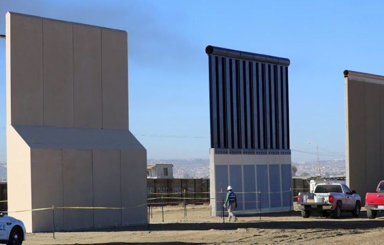 Three of US President Donald Trump's eight border wall prototypes are shown near completion along US - Mexico border in San Diego, California, US.