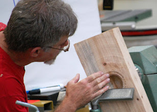 Photo: He adds a decorative bead to define the line between the bowl and the wings.