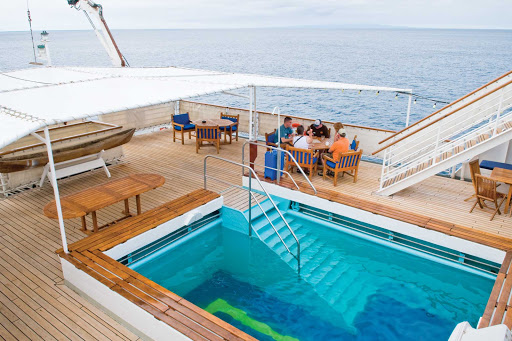 Take a dip in National Geographic Endeavour's swimming pool while on your Lindblad Expeditions vacation.