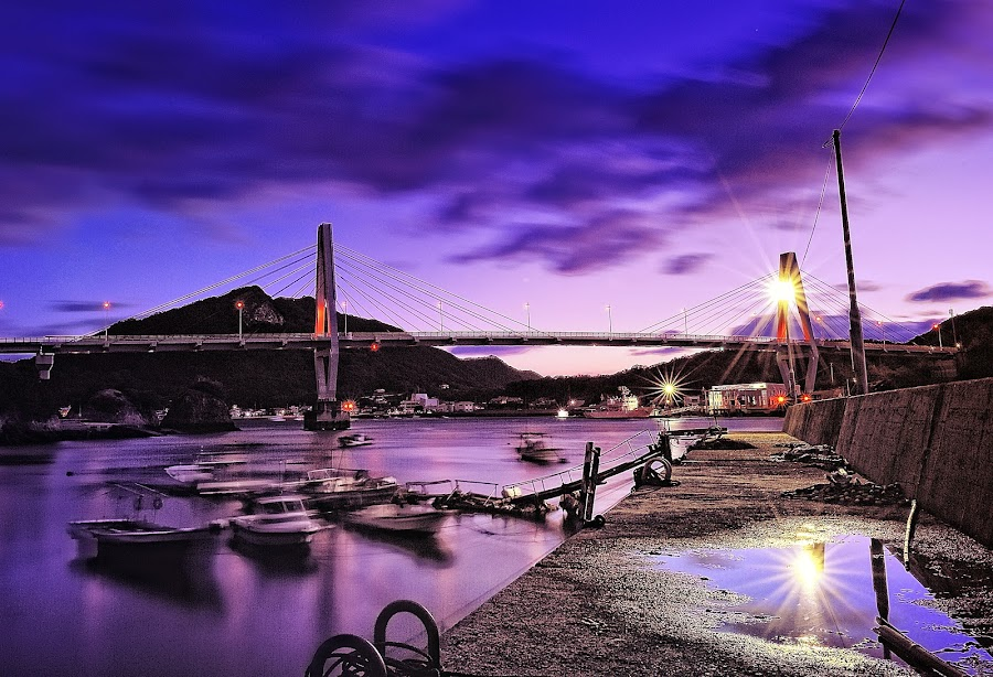 Stillness in the motion by Hiro Ytwo - Landscapes Waterscapes ( purple, bay, boats, sea, reflection.light, sunrise )