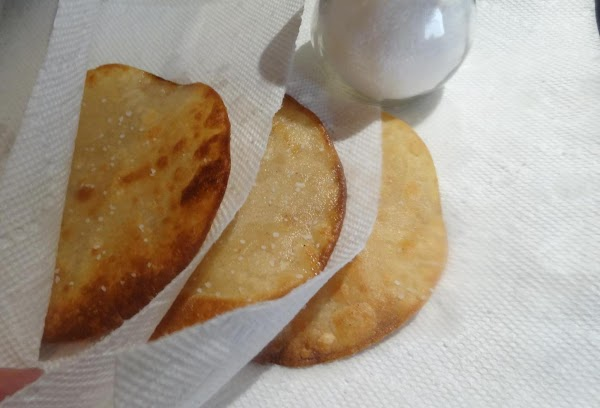 Blot the cooked tortilla with paper towels and immediately sprinkle each fried tortilla lightly...