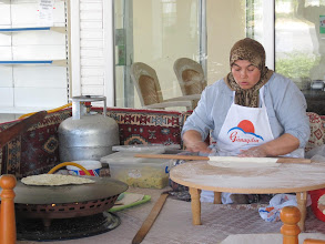 Photo: She's making gozleme, which is a pancake/tortilla that is then stuffed with a number a options ranging from potatoes with herbs to cheese and zucchini. They're really doughy (no surprise) but very tasty. These 'fast food' places are commonly found in the central part of Turkey, and this is how they really make them (i.e., this is not just some touristy demonstration).