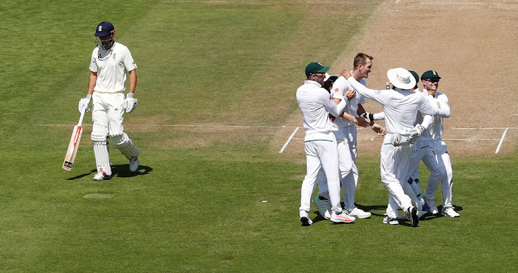 South Africa's Chris Morris celebrates the wicket of England's Alastair Cook with team mates.