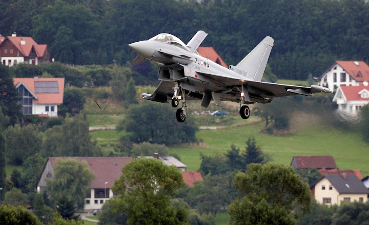 The first Austrian military jet fighter Eurofighter Typhoon lands at the military airport in Styrian village, Austria. Picture:  REUTERS/LEONHARD FOEGER
