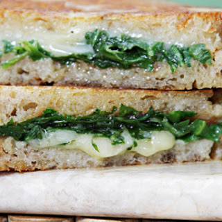 Grilled Cheese Sandwich with Garlic Confit and Baby Arugula.