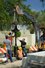 Photo: Team Fishel making final adjustments placing the clock face onto the pedestal of the Scottsdale Rotary Clock at Scottsdale Civic Center Mall - Arizona