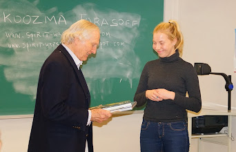 Photo: Koozma receives gift from students Notes and slides at http://www.spirit-wrestlers.com/evolution.html