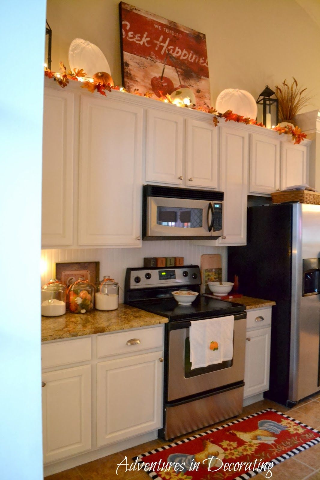 kitchen with fall decor. Rug, towels and small pumpkins