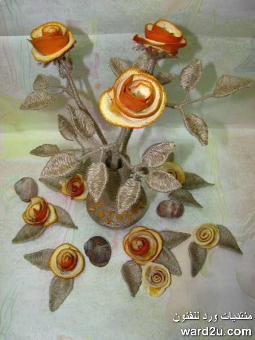 زهور من قشر البرتقال و خيوط الخيش