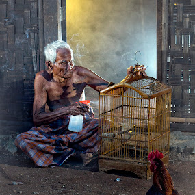 Grandpa and His Bird by Aditya Kristanto - People Portraits of Men ( bird, grandpa, human interest, grand father, jakarta, expressive, father )