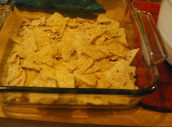 Top with half of the tortilla chips or half of the corn tortillas.