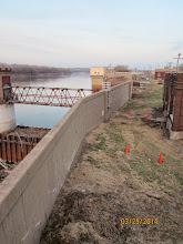 Photo: Kansas City, Kansas, Board of Public Utilities (BPU) floodwall along the Missouri River.  The floodwall improvement project includes the addition of buttresses along the back side of the wall.  The new buttresses are supported on 2ft diameter drilled shafts reinforced with an h-pile.