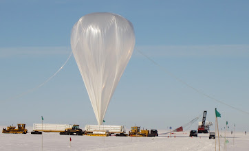 Photo: A photo of the balloon that took the payload into space over Antarctica. You can get an idea of its size by looking at the equipment on the ground, but to really understand, you should know that two 747s could fit inside the balloon with ease.