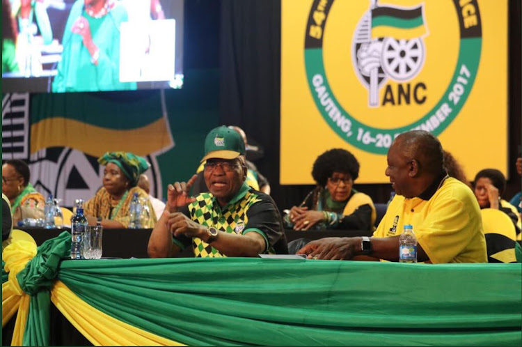 Presidential hopefuls, Nkosazana Dlamini-Zuma (left, behind) and Cyril Ramaphosa (right) with President Jacob Zuma (centre) inside the closed session of the ANC conference on 17 December 2017.