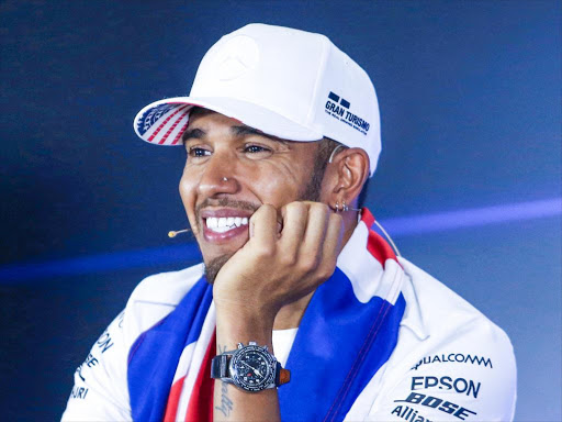 Mercedes' Lewis Hamilton smiles in a past news conference