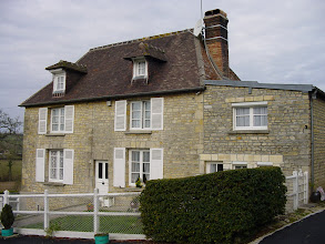 Photo: Cambremer is at the heart of what is called the Cider Route, a circuit linking local villages and small recognized producers of apple cider, Calvados (apple brandy), and Pommeau (an aperitif which is a mixture of the two). Here we are at the home of Mme. Foucher (age 70, and living with her 97 year old mother!), who was kind enough to open her cellar to us for an exclusive tour and tasting of her products. We ended up purchasing 9 bottles of Pommeau – which our hosts later told us was a nice sale for Mme. Foucher on such a Sunday morning.