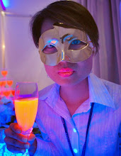 Photo: A Taiwanese model displays fluorescent lipstick and drinks made by fluorescent protein during the Bio Taiwan Exhibition, Thursday, July 26, 2007, in Taipei, Taiwan. The fluorescent protein is multi-application and extracted from algae. (AP Photo/Chiang Ying-ying)