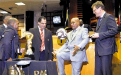 HOW IT'S DONE: President Jacob Zuma demonstrates his skills with a soccer ball given to him by Fifa general secretary Jérôme Valcke, right. Valcke had just handed over the Confederations Cup trophy to Zuma. Circa. 2009. © Unknown.