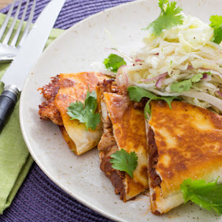 Pulled Chicken Mole Quesadillas with Monterey Jack Cheese & Shredded Cabbage Salad.