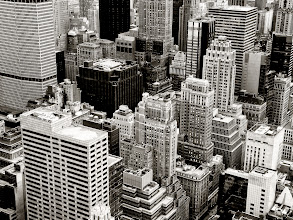 """Photo: """"Flight...""""  Driven by an imagination stirred by visions Batman flying through Gotham, I used to have vivid dreams when I was younger of flying through the skyscrapers that are part of the midtown Manhattan skyline.  This cluster of skyscrapers is one of my favorites. These buildings seem to huddle together in a solemn solidarity: titans comprised of multitudes of urban aspirations.    New York Photography: The skyscrapers of the New York City skyline from above.    You can view this post along with information about where to purchase prints of this image if you wish at my site here:  http://nythroughthelens.com/post/26564848321/looking-out-over-the-skyscrapers-of-new-york-city  -  Tags: #photography  #newyorkcity  #nyc  #newyorkcityphotography  #architecture  #skyline  #newyorkcityskyline  #nycskyline  #manhattan  #city  #cityscape  #landscape  #urban  #urbanphotography  #urbanlandscape  #cityscapephotography"""