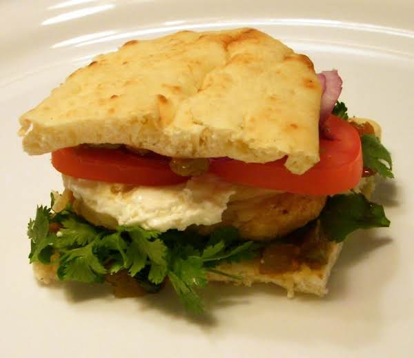 Red Pepper Relish And Whipped And Zipped Up Cream Cheese, Red Onion And Tomatograce This Grilled Chicken Breast Sandwich.