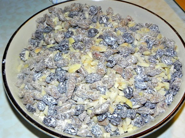 Coat the chopped figs, raisins, and almonds with flour to keep them from sinking...