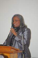 Photo: Rev. Tonya Sumter talks to the women.