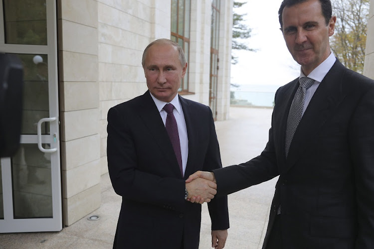 Russian President Vladimir Putin (L) shakes hands with Syrian President Bashar al-Assad during a meeting in the Black Sea resort of Sochi, Russia. Picture: SPUTNIK/REUTERS