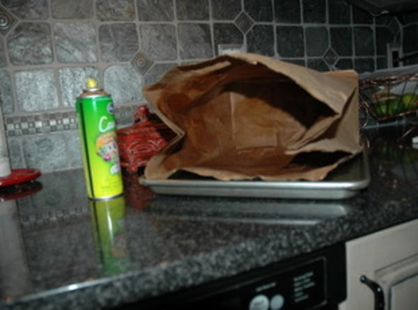 Spray the inside of a brown paper bag with cooking spray.