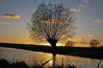 Photo: Nederland Ondergaande zon  Bron: www.picturesofholland.nl  .