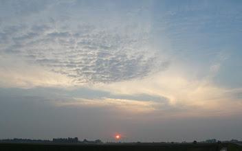Photo: De zon krijgt het even moeilijk