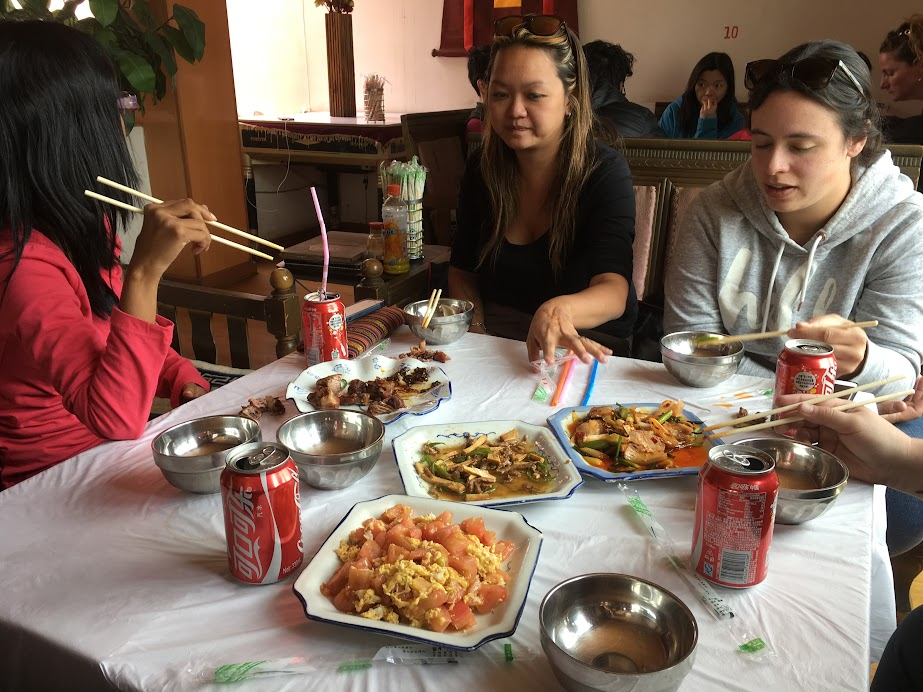 Typical meal time on a Tibet tour. I have a suspicion that my minor food poisoning can be traced to that particular scrambled egg and tomato.