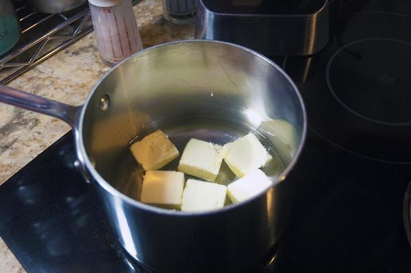 Place the butter, and the water into a saucepan, over medium heat.