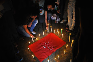 Photo: Around 1000 people attended the candle light vigil in Talat Harb Square.