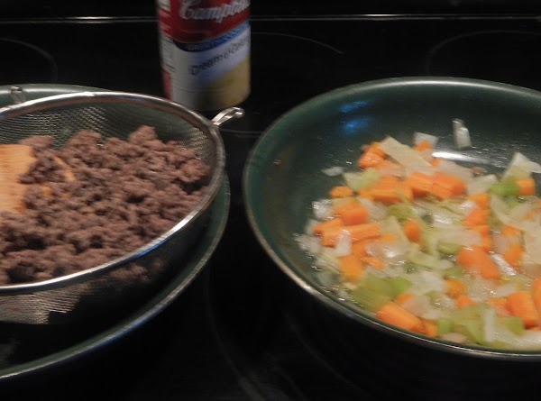 Brown the meat. Set aside. Pre cook the rutabaga.  Drain and set aside.  Sweat the celery,...
