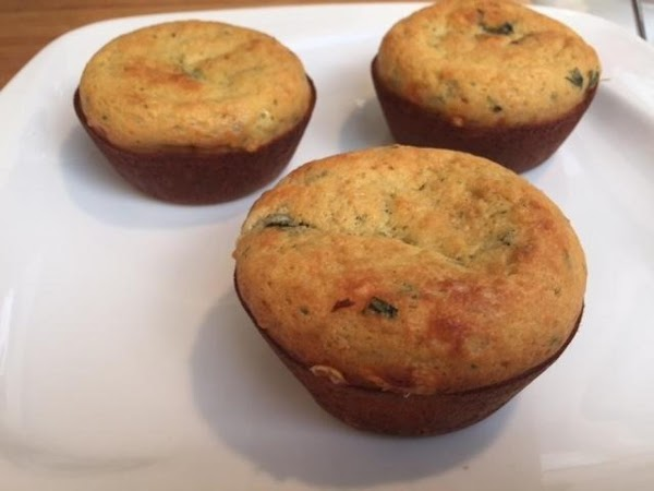Put the muffin tin in the oven, lower the heat to 400, and bake...