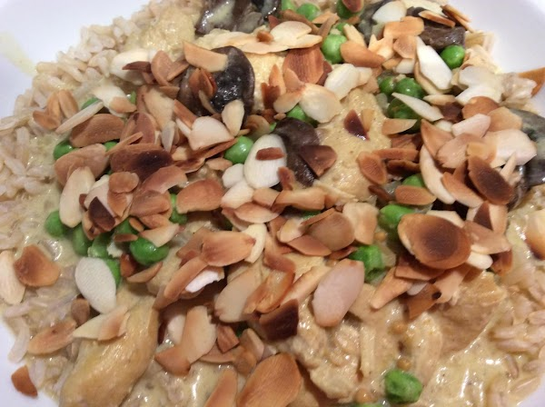 Added some small peas, garnished with toasted almond slices and served over brown rice.