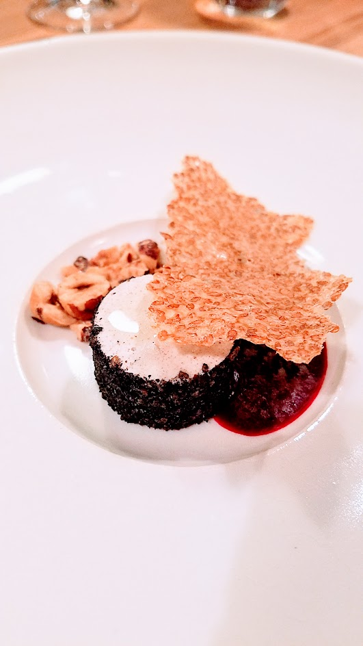 Farm Spirit 7:45 PM seating on December 16th dinner: Dessert 1`of 2, this is the Cultured hazelnut that is vegan but goes through the same process like cheesemaking, here with leek ash, and served with smoked beet juice, hazelnut crumble, and flax cracker