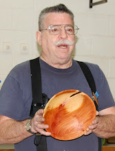 "Photo: Elliot Schantz tells about the ""not another bowl with a crack in it"" mahogany bowl with a bark inclusion."